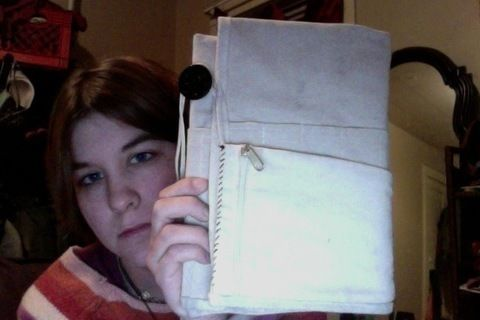 Tools and sketchbook all in one little package .  Make a book cover in under 60 minutes by creating, drawing, sewing, and hand sewing with thread, buttons, and sketchbook. Creation posted by Asherah Arts (formerly Lee Rose). Difficulty: 3/5. Cost: Absolutley free.