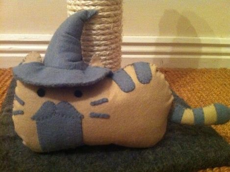 If Gandalf was a cat .  Free tutorial with pictures on how to make a cat plushie in under 60 minutes by felting with felt and stuffing. Inspired by kawaii and pusheen. How To posted by cynthia.zabee. Difficulty: Simple. Cost: Cheap. Steps: 1