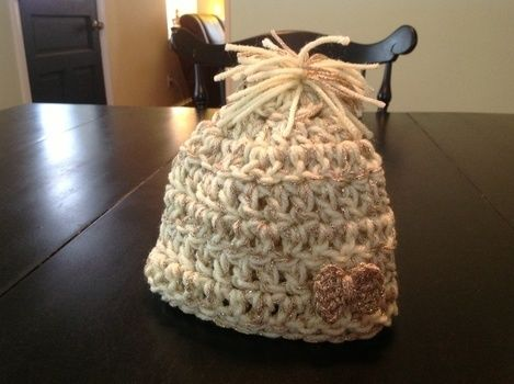 Cute Hat with Little Bow .  Make a baby hat in under 30 minutes by yarncrafting and crocheting with crochet hook and worsted weight yarn. Inspired by clothes & accessories. Creation posted by dgibian. Difficulty: Simple. Cost: 3/5.