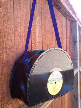 An eye catching purse! .  Make a vinyl record purse by sewing with fabric, ribbon, and zipper. Inspired by gifts, vintage & retro, and clothes & accessories. Creation posted by Steady Scissors. Difficulty: 4/5. Cost: No cost.