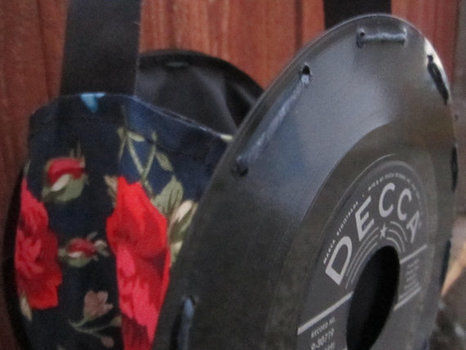 Beautiful novelty! .  Make a vinyl record purse in under 120 minutes by sewing with ribbon, hemp string, and vinyl record. Inspired by gifts, valentine's day, and vintage & retro. Creation posted by Steady Scissors.  in the Home + DIY section Difficulty: 3/5. Cost: 3/5.