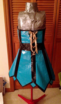 Impractical and Shiny .  Recycle a duct tape dress by dressmaking and not sewing with scissors, ribbon, and duct tape. Inspired by costumes & cosplay and clothes & accessories. Creation posted by .  in the Needlework section Difficulty: 4/5. Cost: Cheap.