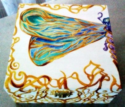 Stylish gift for my Mom's birthday with freehanded Fantasy/Art Nouveau-like painting .  Make a box in under 180 minutes by creating, drawing, and decorating with acrylic paint, wooden box, and acrylic varnish. Inspired by gifts, steampunk, and fairies. Creation posted by Isabela P.  in the Home + DIY section Difficulty: 3/5. Cost: Cheap.