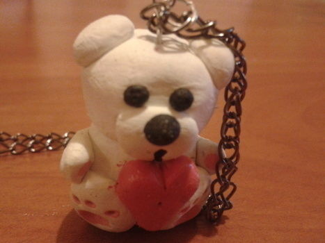 Polar bear .  Mold a clay pendant in under 60 minutes by jewelrymaking with polymer clay, chain, and eye pins. Inspired by animals and bears. Creation posted by Bianka  R.  in the Jewelry section Difficulty: Simple. Cost: Cheap.