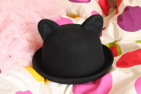 Pep up a spare old bowler with snazzy felt cat ears! .  Free tutorial with pictures on how to make an animal hat in under 60 minutes by decorating with scissors, felt, and stuffing. Inspired by cats, cats, and costumes & cosplay. How To posted by AllyEbdon.  in the Needlework section Difficulty: 3/5. Cost: 3/5. Steps: 12