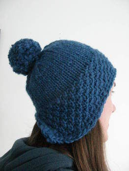 A cute hat that'll keep your ears warm. Knits up quickly in cosy chunky yarn. .  Free tutorial with pictures on how to make a pom pom beanie in under 90 minutes by knitting with yarn. How To posted by Dot W.  in the Yarncraft section Difficulty: Simple. Cost: 3/5. Steps: 1