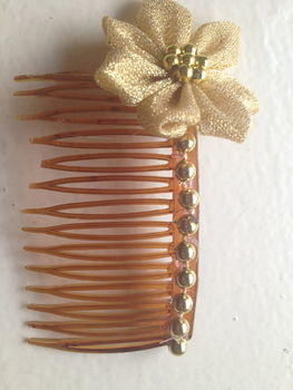 An easy way to dress up a bun! .  Make a hair comb in under 30 minutes by beading, hairstyling, and fusing with beads, materials, and hair comb. Inspired by clothes & accessories. Creation posted by craftiequeen2000.  in the Jewelry section Difficulty: Easy. Cost: Cheap.