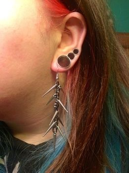 Dangerous. ;) .  Make a set of paper earrings in under 40 minutes by beading, embellishing, jewelrymaking, and decoupaging with beads, chain, and earring hooks. Inspired by halloween, gothic, and punk. Creation posted by DarkAshHurts.  in the Jewelry section Difficulty: Easy. Cost: 3/5.