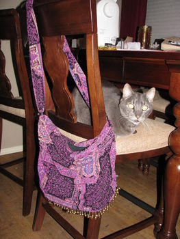 Too small shirt = Too cool purse! .  Free tutorial with pictures on how to make a t-shirt scarf in under 180 minutes by sewing with scissors, thread, and shirt. Inspired by costumes & cosplay, vintage & retro, and clothes & accessories. How To posted by Ravens Trove.  in the Needlework section Difficulty: Easy. Cost: Absolutley free. Steps: 9
