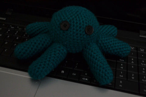 Blue octopus .  Make an octopus plushie in under 120 minutes by sewing, crocheting, and amigurumi with yarn needle, buttons, and yarn. Inspired by gifts and kawaii. Creation posted by Justine :].  in the Yarncraft section Difficulty: Simple. Cost: Absolutley free.