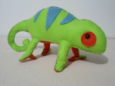 A 20cm length stuffed chameleon. .  Free tutorial with pictures on how to make a reptile plushie in under 180 minutes by needleworking, needlepointing, sewing, and patchworking with felt, beads, and filling. Inspired by gifts, animals, and lizards. How To posted by Lucas B.  in the Needlework section Difficulty: Easy. Cost: Cheap. Steps: 5