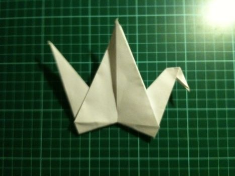 Easy origami crane you can make to decorate  your room :) .  Free tutorial with pictures on how to fold an origami crane in under 4 minutes by papercrafting, paper folding, and paper folding with paper. How To posted by Ellesdot.  in the Papercraft section Difficulty: Easy. Cost: Absolutley free. Steps: 18