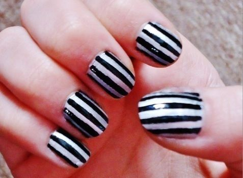 Making stripes the easy way with some stickers! .  Free tutorial with pictures on how to paint a stripy nail in under 45 minutes by nail painting and decorating with scissors, stickers, and nail polish. Inspired by halloween, valentine's day, and gothic. How To posted by Rachel's Craft Channel.  in the Beauty section Difficulty: Simple. Cost: No cost. Steps: 2