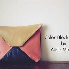 Square colorblockedclutchontable