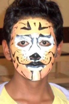 Rawr! tiger face painting .  Create a face painting in under 15 minutes by creating, applying makeup, applying makeup, and applying makeup with acrylic paint. Inspired by cats. Creation posted by priyanka n.  in the Art section Difficulty: Easy. Cost: No cost.