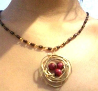Bird's nest pendent .  Free tutorial with pictures on how to make a wire necklace in under 5 minutes by creating, beading, knotting, and wireworking with wire, wire cutters, and pearl beads. Inspired by gifts, birds, and people. How To posted by Riya K.  in the Jewelry section Difficulty: Easy. Cost: No cost. Steps: 5