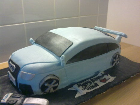 A cake for a friend who likes Audi TT cars .  Decorate a car cake by baking with gel food coloring, fondant icing, and butter cream icing. Inspired by gifts. Creation posted by Ruthsenny.  in the Recipes section Difficulty: 4/5. Cost: 3/5.