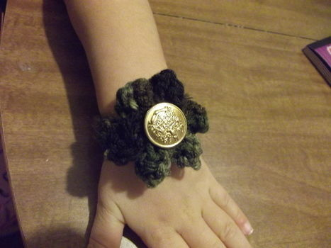 Crochet bracelet .  Make a fabric bracelet in under 15 minutes by yarncrafting, crocheting, and sewing with yarn and buttons. Inspired by for girls, country, and flowers. Creation posted by ChristineMarie.  in the Jewelry section Difficulty: Simple. Cost: Absolutley free.