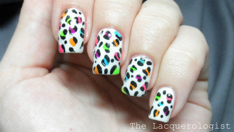 The classic.  A must in every nail artist's skill set! .  Free tutorial with pictures on how to paint an animal nail in under 30 minutes by nail painting and nail painting with nail polish, dotting tool, and top coat. Inspired by leopard print. How To posted by lacquerologist.  in the Beauty section Difficulty: Simple. Cost: Cheap. Steps: 5