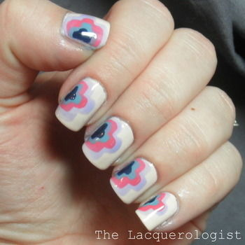 Clouds? Aztec? Tribal?  No matter what you call it, these nails are awesome! .  Free tutorial with pictures on how to paint patterned nail art in under 30 minutes by nail painting and nail painting with nail polish, top coat, and base coat. Inspired by clouds and aztec. How To posted by lacquerologist.  in the Beauty section Difficulty: Easy. Cost: Cheap. Steps: 4