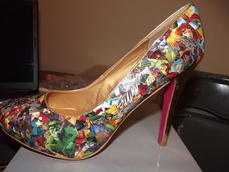 Yet another pair of comic book heels :D this time Avengers .  Make a pair of decoupage shoes by decorating, embellishing, papercrafting, collage, and decoupaging with shoes and comic. Inspired by comic books, geeky, and iron man. Creation posted by ChristineMarie.  in the Art section Difficulty: 4/5. Cost: 3/5.