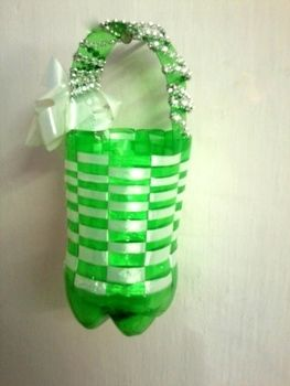 Its very easy to make a cute basket from plastic bottle!!  .  Free tutorial with pictures on how to make a recycled bag in under 7 minutes by knotting and not sewing with ribbon, stapler, and plastic bottle. Inspired by gifts and people. How To posted by Riya K.  in the Home + DIY section Difficulty: Easy. Cost: No cost. Steps: 12