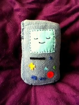 <3 .  Make a gadget plushie by needleworking, embroidering, and sewing with fabric and needle and thread. Inspired by robots, costumes & cosplay, and kawaii. Creation posted by craftylilred. Difficulty: Easy. Cost: No cost.
