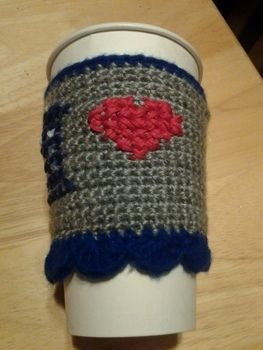 With the Doctor's two hearts this cozy is perfect! .  Make a mug warmer in under 180 minutes by cross stitching and crocheting with red heart yarn, caron simply soft yarn, and embroidery thread. Inspired by gifts, valentine's day, and hearts. Creation posted by Angela M.  in the Yarncraft section Difficulty: 3/5. Cost: Cheap.