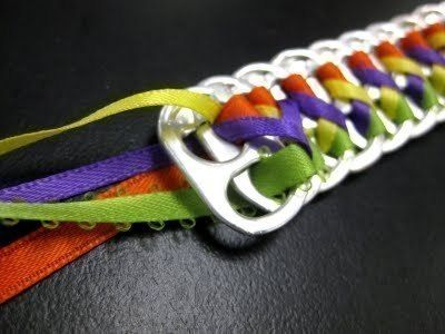 Creative recycle of soda can tabs .  Free tutorial with pictures on how to make a pop tab bracelet in under 50 minutes by jewelrymaking with can tabs and lace ribbon. Inspired by gifts and clothes & accessories. How To posted by Riya K.  in the Jewelry section Difficulty: Simple. Cost: Cheap. Steps: 12