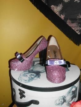 Turn a boring pair of shoes to a glittery wonderland .  Decorate a pair of glitter shoes by decorating and embellishing with glitter, shoes, and sand paper. Inspired by burlesque & pinup. Creation posted by jasmine.turner.75491.  in the Decorating section Difficulty: Simple. Cost: Cheap.