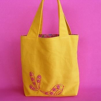 Showcase your mad embroidery skills or use some fabulous fabric to make this mini tote bag. .  Free tutorial with pictures on how to stitch an embroidered tote in under 60 minutes by sewing with fabric. How To posted by Wendi G.  in the Sewing section Difficulty: Easy. Cost: Cheap. Steps: 9