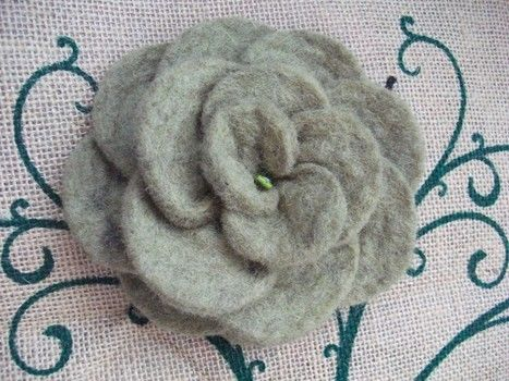 Large green felt rose brooch .  Sew a fabric flower brooches in under 30 minutes by jewelrymaking, needleworking, sewing, felting, and hand sewing with felt, thread, and glass beads. Inspired by flowers and clothes & accessories. Creation posted by sian d.  in the Needlework section Difficulty: Easy. Cost: Cheap.
