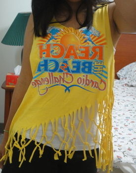 Cute summer T-shirt! .  Free tutorial with pictures on how to make a fringed top in under 120 minutes by sewing, dressmaking, and not sewing with t shirt, ruler, and fabric scissors. Inspired by clothes & accessories. How To posted by Pramodini Arela.  in the Needlework section Difficulty: Easy. Cost: No cost. Steps: 9