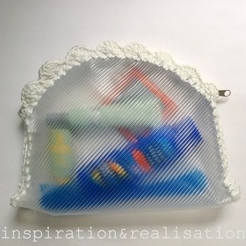 Catching a plane? forget about the ziplock bag! .  Free tutorial with pictures on how to make a pouch, purse or wallet in under 90 minutes by sewing with crochet hook, zipper, and hole punch. How To posted by Donatella M. Difficulty: Easy. Cost: Cheap. Steps: 10