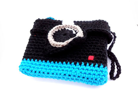 Click click click .  Stitch a knit or crochet pouch in under 120 minutes by crocheting and amigurumi with crochet hook and cotton yarn. Inspired by gifts, vintage & retro, and clothes & accessories. Creation posted by EVEnl.  in the Yarncraft section Difficulty: Simple. Cost: Absolutley free.