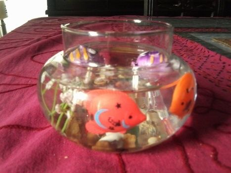 Fish Bowl You Never Need To Care For and is decorative .  Free tutorial with pictures on how to create art / a model in under 10 minutes using toy, glass fish bowl, and stones. Inspired by fish. How To posted by Riya K.  in the Other section Difficulty: Simple. Cost: Cheap. Steps: 10