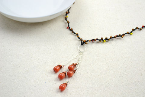 Beaded string jewelry-diy fringe necklace for girls  .  Free tutorial with pictures on how to bead a beaded tassel necklace in under 120 minutes by jewelrymaking with jump rings, chain, and seed beads. Inspired by clothes & accessories. How To posted by .  in the Jewelry section Difficulty: Easy. Cost: Cheap. Steps: 7