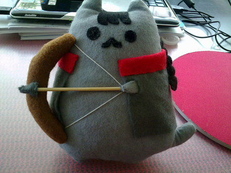 Hunger Games' Katniss ( it's actually called CATniss Pusheen ^.^ ) in a fluffier form :) .  Free tutorial with pictures on how to make a cat plushie in under 180 minutes by sewing and hand sewing with fabric, thread, and needle. Inspired by cats, kawaii, and the hunger games. How To posted by Ana M.  in the Sewing section Difficulty: Simple. Cost: Absolutley free. Steps: 14