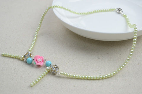 Ivory pearls necklace adorned by flower and turquoise .  Free tutorial with pictures on how to make a pearl necklace in under 120 minutes by jewelrymaking with beads, eye pins, and flat nose pliers. Inspired by clothes & accessories. How To posted by .  in the Jewelry section Difficulty: Easy. Cost: Cheap. Steps: 7