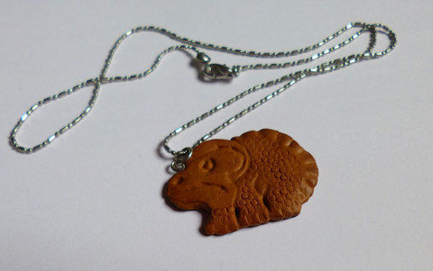LU Dinosaur cookie .  Sculpt a clay food necklace in under 60 minutes by jewelrymaking with paint and polymer clay. Inspired by dinosaurs, cookies, and clothes & accessories. Creation posted by Minimax.  in the Jewelry section Difficulty: 3/5. Cost: Absolutley free.