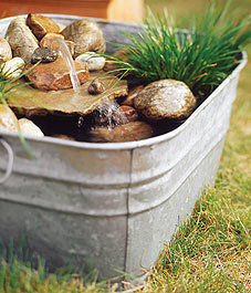 This project uses terra cotta flower pots. Plus, add fish, turtles, or plants .  Free tutorial with pictures on how to make a rock garden in 6 steps by constructing, decorating, and gardening with water plants, pump, and rocks. Inspired by garden and flowers. How To posted by Harmonee.seal.  in the Home + DIY section Difficulty: 4/5. Cost: 4/5.