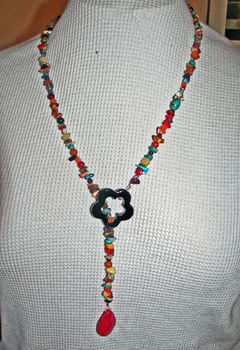 Chippy Onyx Lariat w/ Jade Pendant .  Make a rosary necklace in under 180 minutes by beading and jewelrymaking with glass beads, beading wire, and crimp beads. Inspired by gifts, flowers, and clothes & accessories. Creation posted by ESME K.  in the Jewelry section Difficulty: Easy. Cost: 3/5.