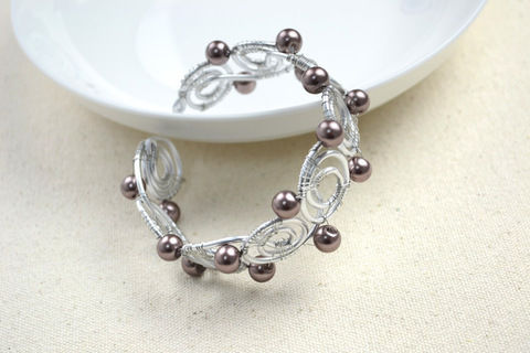 Wire bracelet designs-how to diy bangle bracelets in super cool pattern  .  Free tutorial with pictures on how to make a wire bracelet in under 120 minutes by jewelrymaking with wire, pearls, and cutting pliers. Inspired by clothes & accessories. How To posted by .  in the Jewelry section Difficulty: Easy. Cost: Cheap. Steps: 6