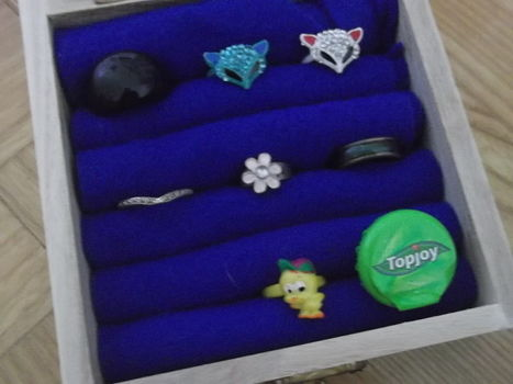 A nice method to organize your rings .  Make a box in under 30 minutes using ruler, fabric scissors, and wooden box. Creation posted by peardepression.  in the Home + DIY section Difficulty: Simple. Cost: Cheap.