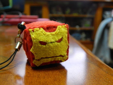 Iron man's head been cut off.haha .  Sew a fabric character charm in under 150 minutes by needleworking and felting with felt, thread, and fiberfill. Inspired by iron man and cubes. Creation posted by mayaliyana.  in the Needlework section Difficulty: 3/5. Cost: 3/5.