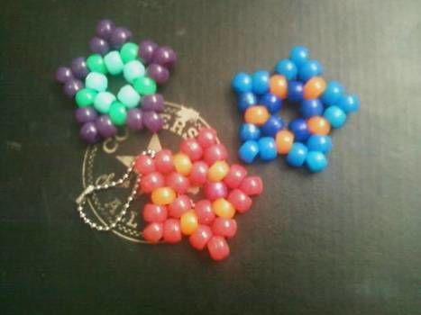 How to make Kandi Stars.  .  Free tutorial with pictures on how to bead a beaded shape in under 3 minutes by beading, jewelrymaking, and beading with beads, clear nail polish, and clear stretchy string. Inspired by stars, stars, and clothes & accessories. How To posted by Princess Zelda.  in the Jewelry section Difficulty: Easy. Cost: Cheap. Steps: 6