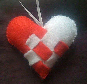 How to make heart shaped bag accessories .  Free tutorial with pictures on how to sew a fabric heart charm in under 45 minutes by not sewing with scissors, felt, and paper. Inspired by gifts, kawaii, and hearts. How To posted by .  in the Other section Difficulty: Easy. Cost: No cost. Steps: 3