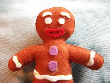 The Shrek's Cookie! .  Free tutorial with pictures on how to make a gingerbread man plushie in under 120 minutes by sewing, felting, and hand sewing with felt and cotton. Inspired by gifts, shrek, and gingerbread. How To posted by KozmicBlues.  in the Needlework section Difficulty: Simple. Cost: Cheap. Steps: 2