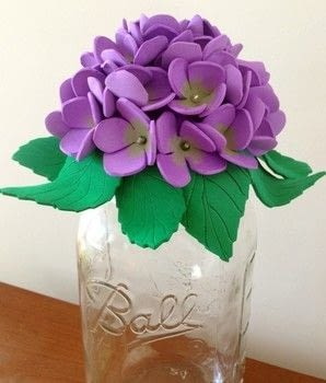 Learn how to make mason jar hydrangea flowers decorative tops using hear and foam sheets .  Free tutorial with pictures on how to make a flowers & rosettes in under 180 minutes by creating, decorating, embellishing, and papercrafting with foam, iron, and sharpie. How To posted by Gail G.  in the Other section Difficulty: Easy. Cost: Cheap. Steps: 3
