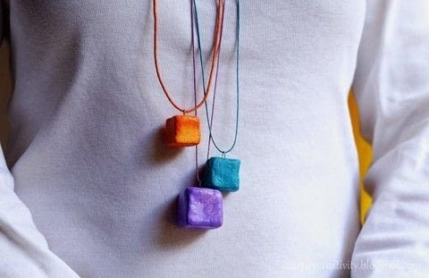 Cube clay necklace .  Free tutorial with pictures on how to mold a clay pendant in under 180 minutes by jewelrymaking How To posted by Anna Spathari.  in the Jewelry section Difficulty: Simple. Cost: Cheap. Steps: 4